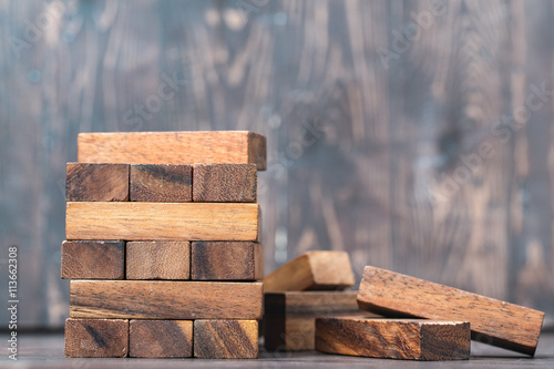 Fotografie, Obraz  Blank wooden block leaning on a structure made of many other blo
