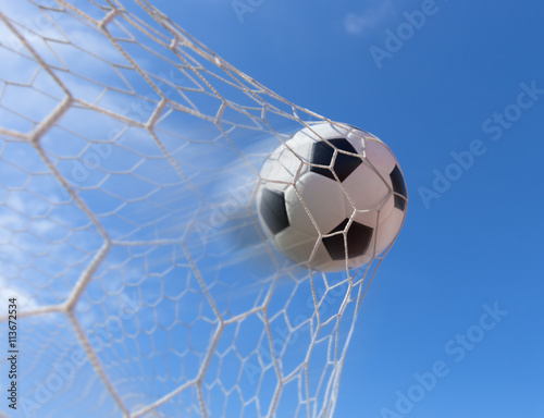 Fototapety, obrazy: soccer ball in goal with blue sky