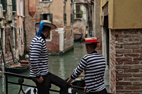 Fototapeta Gondoliers in Venice