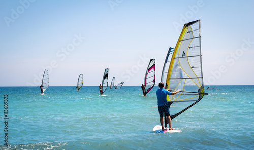 obraz lub plakat Windsurfing sails on the blue sea