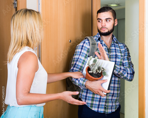 Valokuva  adult watching how spouse moving out with baggage