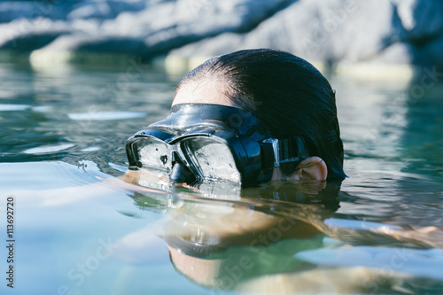 Woman Having a Bath in a Secret Natural Spot Poster