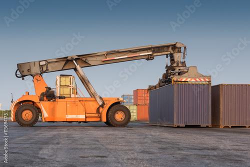 Fotografie, Obraz  forklift handling holding container box