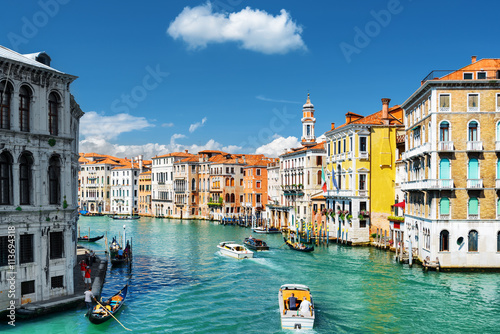 Photo  The Grand Canal with gondolas and boats. Colorful houses, Venice