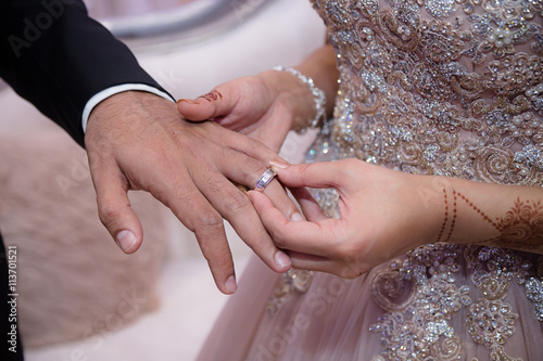 Foto op Canvas Pedicure putting on grooms ring