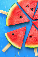 Watermelon Slice Popsicles On A Blue Rustic Wood Background, Pop