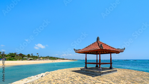 Foto op Aluminium Bali Beach hut on a pier overlooking a beautiful tropical beach on the Island of Bali, Indonesia.