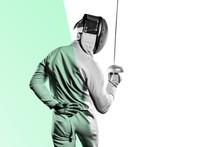 Man Wearing Fencing Suit Pract...