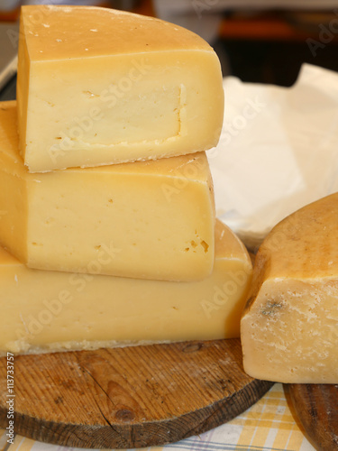 Printed kitchen splashbacks Dairy products tasty riped cheese for sale in the market