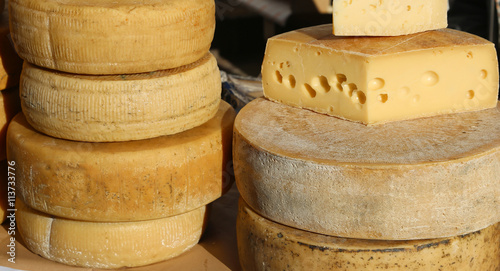 Poster Produit laitier Many cheeses and aged cheeses on sale in the food market