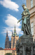 Prague, Czech Republic - May 28, 2016: King Charles IV monument at Crusaders' Square in Prague. St. Vitus cathedral at Prague castle in background.