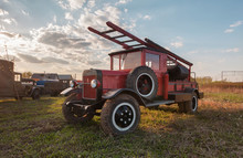 Old Retro Fire Truck With Wooden Case On The Field