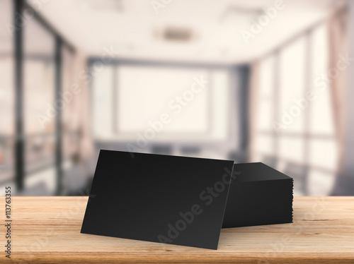 Fototapeta black blank name card with office background obraz na płótnie