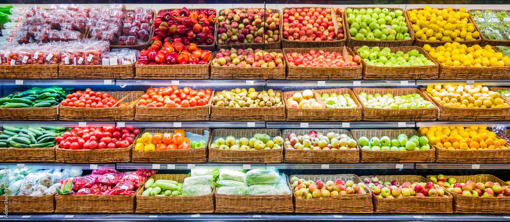 Fototapeta Fresh fruits and vegetables on shelf in supermarket