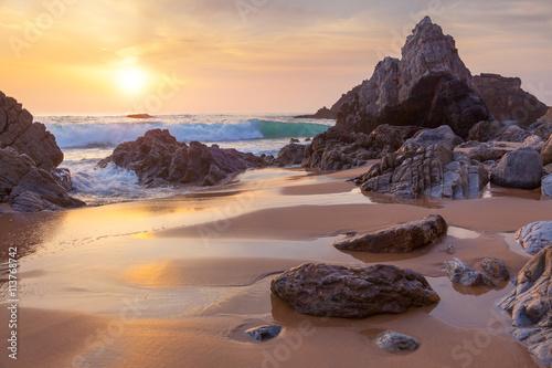 Poster Cappuccino Fantastic big rocks and ocean waves at golden sundown
