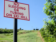 No Sledding Or Tubing On Ski Hill Sign In The Summertime