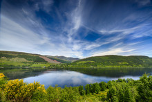 Beautiful Reflections Over Loch Tay, Scotland.  Mountains In The Background.  A Summers Day.