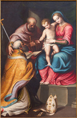 FototapetaCREMONA, ITALY - MAY 24, 2016: The painting of Holy Family with the st. Nicholas in church Chiesa di Santa Agata by Bernardino Campi (1522 - 1591).
