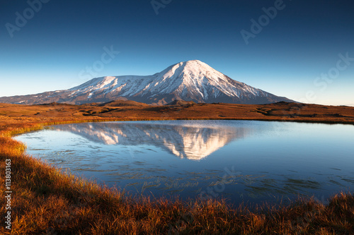 Photo Stands Reflection the tundra in mountains
