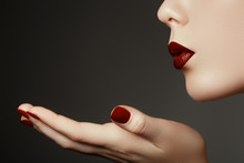Beautiful Young Woman Blowing A Kiss From Her Hand