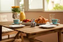 Beautifully Arranged Table On A Sunny Terrace