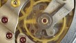 Metal cogwheels inside clockwork. Concept Eternity, Teamwork , Idea Technology. Macro. Tick-Tick Sound