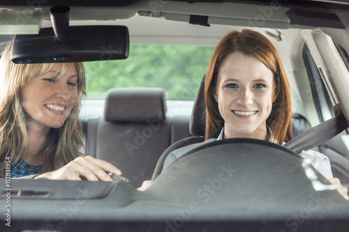 Fotografiet  Teenager in car with driving instructor