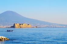 "Castel Dell'Ovo (italian For The ""Egg Fortress"") In The Port Of Naples, Italy With Volcano Vesuvius"