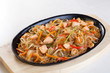 crystal noodles with vegetables chicken in a pan isolated cast iron wok