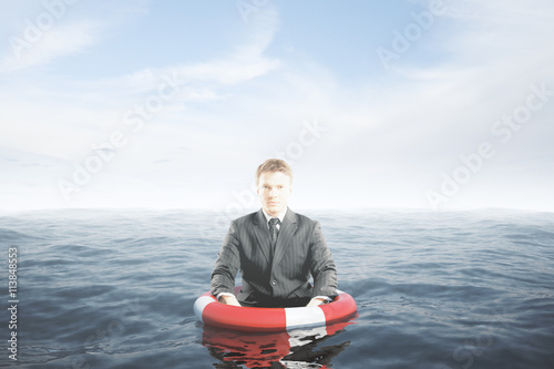 Businessman with lifebuoy Wallpaper Mural