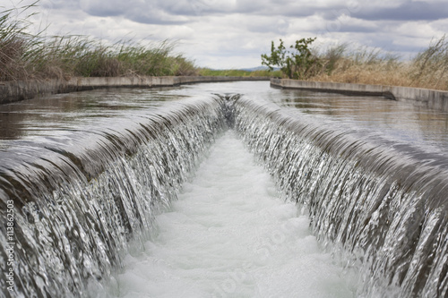 Tuinposter Kanaal Floodgate area at huge irrigation canal, Extremadura, Spain
