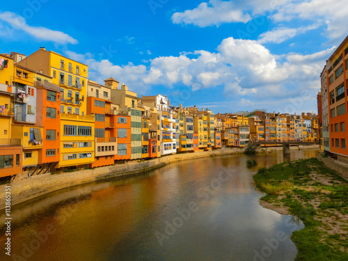 Colorful yellow and orange houses in Girona, Catalonia, Spain.