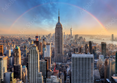 Photo sur Aluminium New York New York City skyline with urban skyscrapers and rainbow.