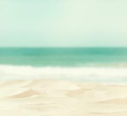 Fototapeta na wymiar Empty sand beach in front of sea background