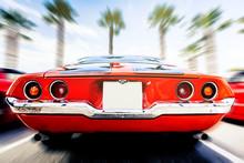 Back View Of Classic 1972 Chevrolet Camaro In Orange Color, In Motion. Speeding.