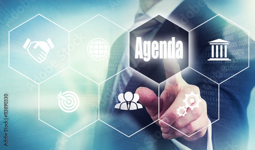 A businessman selecting a Agenda Concept button Wallpaper Mural