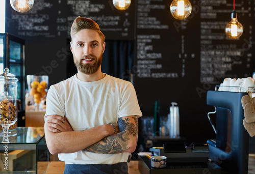 Happy barista standing at trendy coffee shop, cafe - small busin