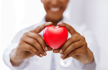 african female doctor with red heart