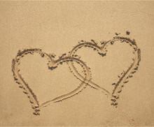Two Hearts On Sandy Beach