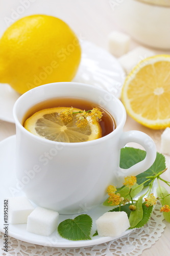 Fototapety, obrazy: Herbal tea with linden flowers and lemon