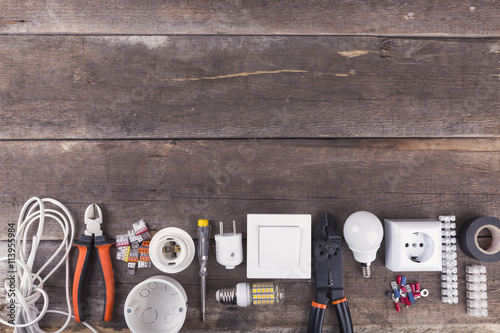 Fotografía  electrical tools and equipment on wooden background with copy space
