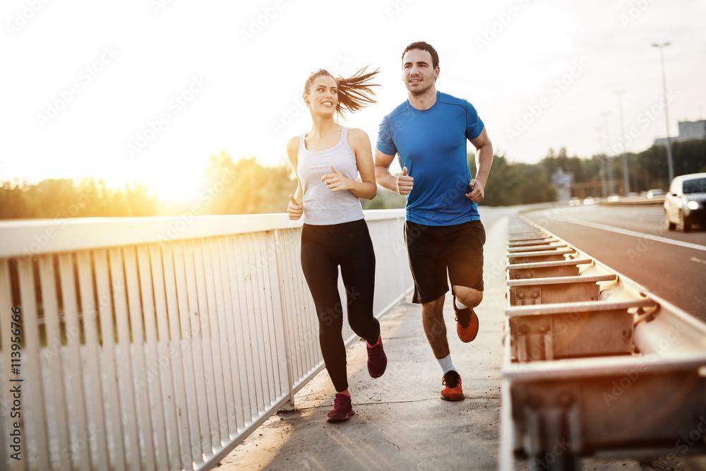 Fototapeta Active couple jogging