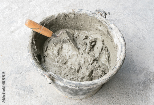 Photo  Pick up a trowel and cement mix concrete is compacted sand