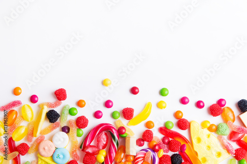 Foto op Plexiglas Snoepjes Mixed colorful candies, jellies and lolly pops on the white background. Top view with copy space