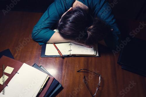 Valokuvatapetti Woman Sleeping On Desk
