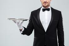Closeup Of Waiter In Tuxedo An...