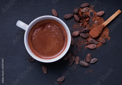 Hot chocolate in a cup on the black background