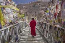 A Monk Walks Onthe Bridge Path...