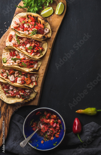 Fototapeta  Shrimp tacos with homemade salsa, limes and parsley