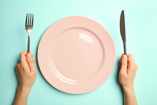 Female Hands With Cutlery And ...
